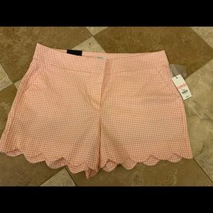 Coral and white scalloped shorts